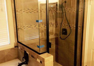 Standing Shower with black framed glass door