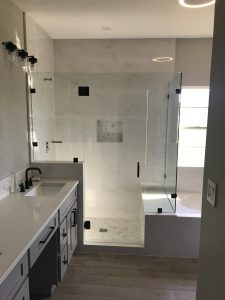 Open concept shower with bench