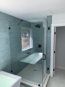Open concept shower with tub